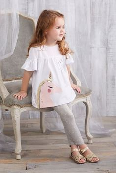 """Jersey short sleeve tunic features poplin chest piecing with ruffle sleeves, glitter printed """"fantastical"""" sentiment, gold lurex neckline piping, chest pocket with gold star studs and cotton spandex unicorn applique with sequin, printed glitt Baby Outfits, Outfits Niños, Little Girl Outfits, Little Girl Fashion, Baby Girl Dresses, Toddler Fashion, Boy Fashion, Baby Dress, Kids Outfits"""