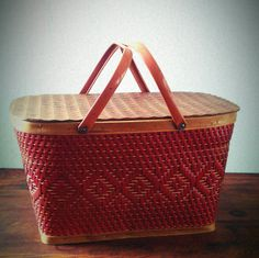 Wonderful 1950s - 60s Red-Man picnic basket...perfect for carrying lunch to the park!    In good vintage condition with light wear. Some