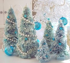 frosted bottle brush trees, pearl roping, tiffany blue ornaments.