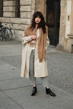 The perfect look for autumn- a tan trench with a darker scarf, grey trousers and black boots