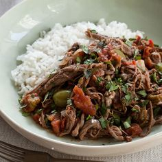 This Cuban stew, featuring shredded flank steak, tomatoes and olives, can be made up to two days in advance