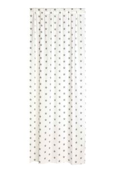 Patterned curtain length: Curtain length in a patterned cotton weave with a wide cased heading. Hemming tape included. Contains one curtain length.