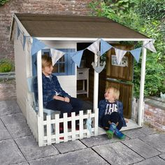 The Basil Country Cottage Playhouse has a unique design with a large covered veranda surrounded by white fencing, a stable-style door and windows with shutters Garden Playhouse, Playhouse Outdoor, Garden Toys, Garden Sheds, Sheds Direct, Buy Shed, Childrens Playhouse, Wendy House, Garden Buildings