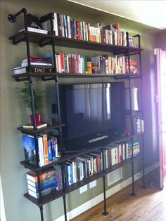 DIY bookshelf! Galvanized piping and wood planks.
