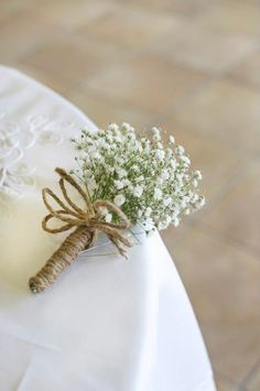 burlap baby's breath boutonniere -- it's happening (and it's uber cheap!)  Another posibility, maybe add the teal burlap rose?