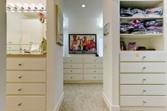 Master suite closet with his and hers wardrobes and custom built-ins. Designed and built by Ramage Company.