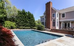 beautifully landscaped property with an 18 x 31' gunite pool with sliding cover.