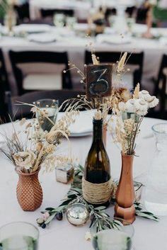 30 Rust Wedding Color Ideas ❤ rust wedding color centerpiece glass bottles original vases with dry flowers briana morrison Wedding Table Centerpieces, Flower Centerpieces, Flower Arrangements, Wedding Decorations, Table Decorations, Centerpiece Ideas, Beachy Centerpieces, Boho Wedding, Fall Wedding