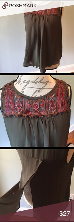 Green sheer embroidered top Lightweight year hunter green importer top. Sleeveless with a buttonhole back. Back has a flap open.  Embroidered mesh top in front. Measures 20 inches armpit armpit. Measures 25 1/2 inches from back of neck to bottom. Tops Blouses