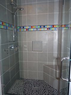 Cheerful Interiors, LLC contemporary bathroom [maybe something sort of like this with cream colored tile and an accent strip. could so glass penny round tiles on floor]