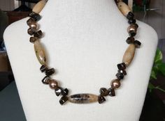 A personal favorite from my Etsy shop https://www.etsy.com/listing/269274105/22-inch-necklace-in-crackled-agate-tube