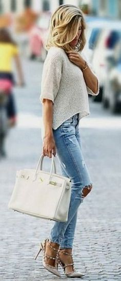 Distressed denim + cropped sweater.
