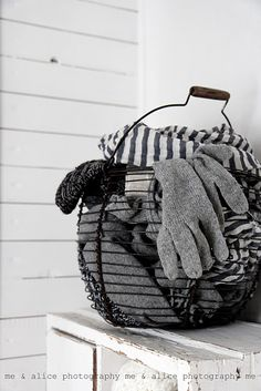 a basket by the door for thrown-off fuzzies. ❥