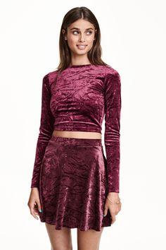 Burgundy crushed velvet long sleeved crop top & mini skirt set