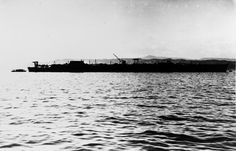 "Unfinished Japanese aircraft carrier ""Aso"" at the dismantling in Tainouchi, near Kure, 1948.  ""Aso"" is a light aircraft carrier of the ""Unryu"" type (15 units were ordered, 6 were built, 3 were completed, had no time to participate in combat operations), was released in June 1943, released in November 1944, January 1945, when the ship was 60% ready. In 1947, it was dismantled"