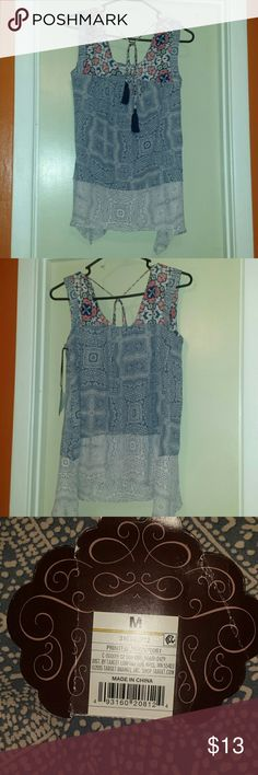 Multi-Colored Sleeveless Top Omg.. this blouse is GORGEOUS!!! The material, the colors, the patterns... PERFECT for the summer! Brand new with tags still attached! Knox Rose Tops Blouses