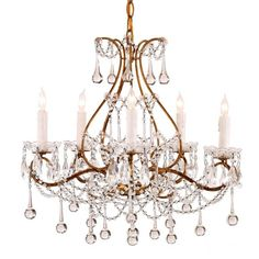 Currey and Company Paramour Chandelier is known for its classic design and elegant finishes, features a 5 candelabra lights and a 6'length hung chain with a white finish socket.  Measurement: 19rd x 18h Finish: Smoke Gold Material: Wrought Iron and Crystak Maximum Wattage: 60w Return Policy: This item is not eligible for returns or exchanges so please make sure to look over…