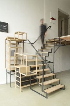 Industrial Landscape 01  is a staircase installation developed for Christian Ouwens' gallery in Rotterdam (NL). The installation connects the ground floor with the first floor and combines its stairway function with spaces for storage, collection and display.