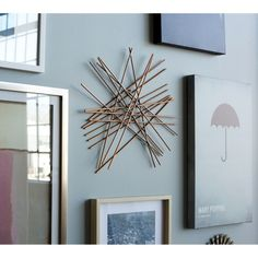 Nate Berkus Starburst Wall Decor - Gold ***This would be so easy to make with dowel rods and gold spray paint!  It would probably cost about $5!***