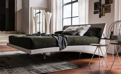 Striking angular leather bed with on chromed steel feet. The Dylan is available in Synthetic or Soft Leather.