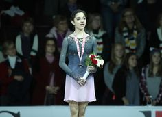 Evgenia Medvedeva of Russia sings along to the playing of the Russian national anthem as she stands on the medal podium with her gold medal after winning the Women's Singles Free Program during day two of the 2016 Skate Canada International at Hershey Centre on October 29, 2016 in Mississauga, Canada.