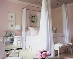 Pale Pink Bedroom with White Canopy Bed- love the paint color and mirrored nightstand