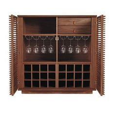 The Line Wine Bar has two drawers with leather pulls, one open cubby, two storage racks for stemware and two storage racks for a total of 24 bottles, twice the storage as the Line Bar. (The bottle storage racks are removable.) Made in Malaysia.