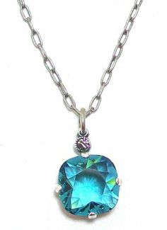 """Catherine Popesco Sterling Silver Plated Teal Swarovski Crystal Drop Necklace Catherine Popesco. $52.95. Sterling """"Old"""" Silver over a copper base. 16"""" And 2"""" extender. .5"""" faceted square Teal crystal drop. Made in France by designer Catherine Popesco. We use Swarovski crystal, the finest Austrian crystal available."""