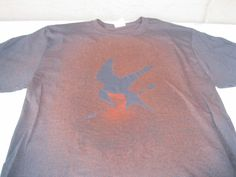Download stencil from the web, place on black t-shirt, spray w/ bleach/water.