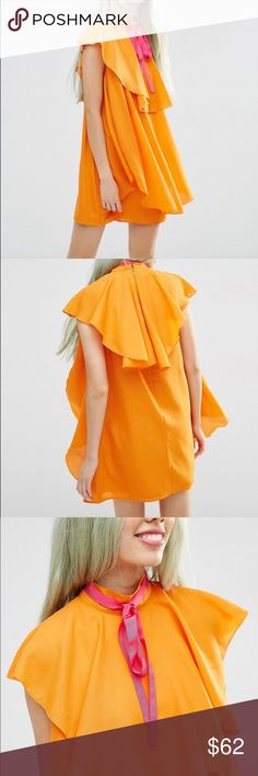 Asos High Neck Ruffle Shift Mini Dress Lined Chiffon with a high neckline and a Grosgrain necktie. The dress also features Ruffle layers and a zip back with a hook and eye fastening. It's 100% Polyester. The model is wearing a US 4 ASOS Dresses