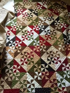 When my mail lady showed up yesterday with these quilt tops in need of frosting, I warned her that the following day would be two ro...