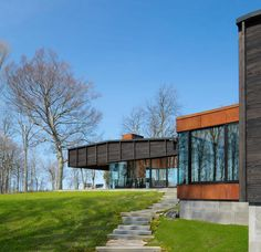"""Desai Chia Architecture designed the Michigan Lake House using """"shou sugi ban"""" on the exteriors. Shou Sugi Ban is a traditional Japanese method of charring"""