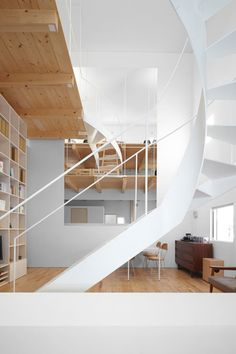 A curvy staircase connects the floors in the Case House designed by Jun Igarashi Architects