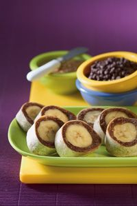 Banana Roll-Ups: 1/4 cup almond butter 1-2 Tblsp milk 2 Tblsp mini choc chips or toffee pieces 1 Whole wheat flour tortilla 1 large banana combine almond butter, milk and chips or pieces in microwavable bowl and microwave  (on MED %) 30-45 seconds (more/less to melt choc)  Spread mixture on tortilla and then wrap banana in tortilla.  Cut into bite size pieces and ENJOY!!!
