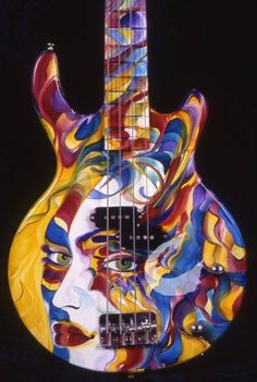 Guitar art. Idea: A smaller face, a harlequin perhaps? Harley Quinn (from the Batman comics) would also be a great fit.