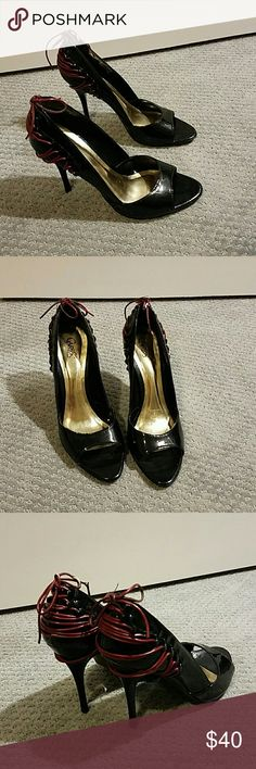 Carlos Santana sinister shoe size 9 A pair of high heel shoes, black with red ties in the back. Some wear  on the red strings but otherwise great condition. Leather, man made in Brazil. Beautiful! Carlos Santana Shoes Heels