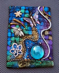 Spring Winged Things ACEO  A little ACEO I created with polymer clay, metal charms, glass gems and powdered pigments. Vibrant happy colors!