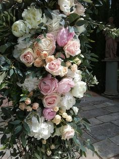 Blush pink floral archway detail   Tuscany wedding at Villa Vignamaggio