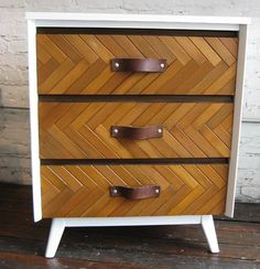 Lathing strips stained and cut in lengths to form a chevron pattern on these chest drawer fronts
