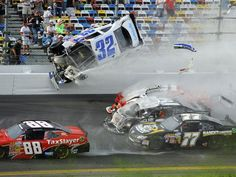 Kyle Larson (32) flies into  the catchfence after a