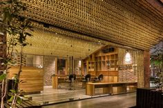 two hundred thousand strings of wooded beads cover the ceiling of the interior of this hairdressers in hanoi.