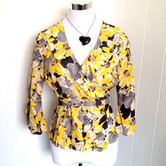 {Stunning} Yellow Floral Wrap Blouse Medium Such a gorgeous top. Real wrap so you have to stick the tie through a hole in the one side and thru a loop on the other. Petite medium should fit regular medium too. LOFT Tops Blouses