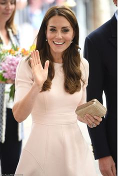 Kate carried a small woven box clutch as she commenced a day of engagements in…