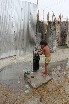 Washing Clothes In Winter Chill MahaKumbh, via Flickr.