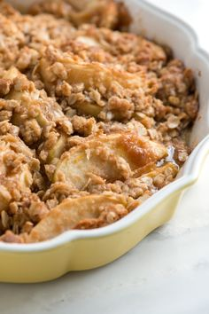 This apple crisp recipe with oats has sweet tender apples and a crisp and crunchy topping made with flour, oats, brown sugar, butter and cinnamon. From inspiredtaste.net | @inspiredtaste