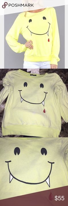 Wildfox Light Yellow Vampire Fangs still in good condition... slight pilling natural ..this is jumper material sweater light color yellow Wildfox Sweaters
