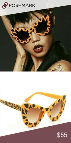 "Fierce  Cat Eyed Sunnies ""I got the eye of the tiger, a fighter Dancing through the fire 'Cause I am the champion, and you're gonna hear me roar..."" Katy Perry""  Fun sunglasses. Bring out the fierce in YOU!  New/never worn. Includes complimentary case  Non-smoking house Accessories Sunglasses"