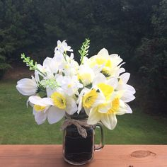 A personal favorite from my Etsy shop https://www.etsy.com/listing/233404171/daffodils-larkspur-floral-arrangement