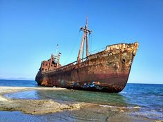 A rusty shipwreck in gytheion, greece