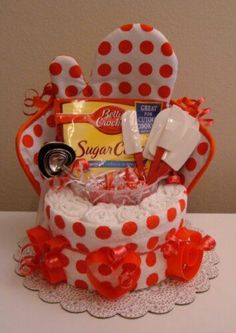 Rolled Dish towels used for the base, fill goodies for the kitchen.  Perfect for a gift basket or door prize